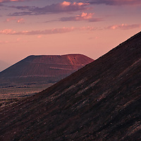 Sunrise light on extinct volcano cone in the Cinder Cone National Monument of Mojave National Preserve