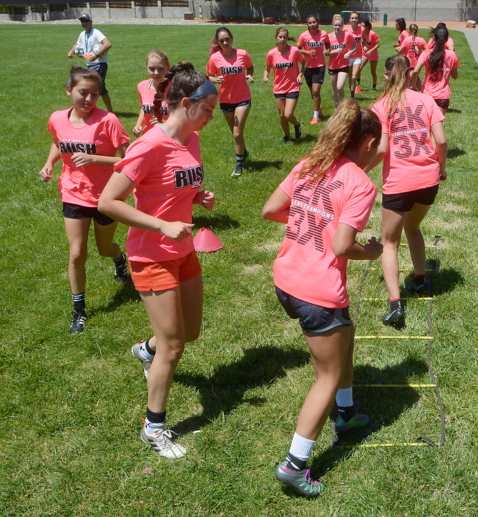 gbs061517b/SPORTS -- The New Mexico Rush U-18 team run ladder drills in Loma del Norte Park on Thursday, June 15, 2017. (Greg Sorber/Albuquerque Journal)