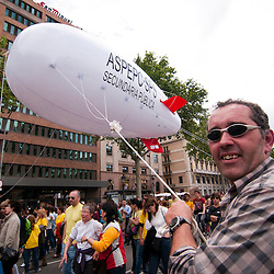Protestors carry helium blimp through the streets of Barcelona as part of a protest to educational cuts.