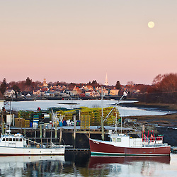 Lobster boats,  the city of Portsmouth, and the moon as seen from a bridge in New Castle, New Hampshire.
