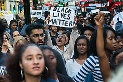 London, July 8th 2016. Hundreds gather on London's Southbank before marching through the streets of London to Parliament Square, Downing Street and the BBC, in a Black Lives Matter protest in solidarity with Americans following the shooting dead of two black men, Philando Castile in Minnesota and Alton Sterling in Louisiana by police in the US. PICTURED: A woman yells out slogans as he's marches along Regent street.