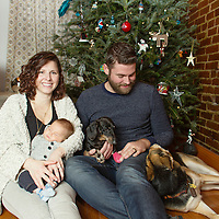In-home lifestyle family & dog portrait for Christmas in St. Louis, MO.