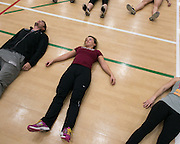 Alex Caldwell, center, stretches with her teammates at track practice at St. John Fisher College on Friday, November 7, 2014.