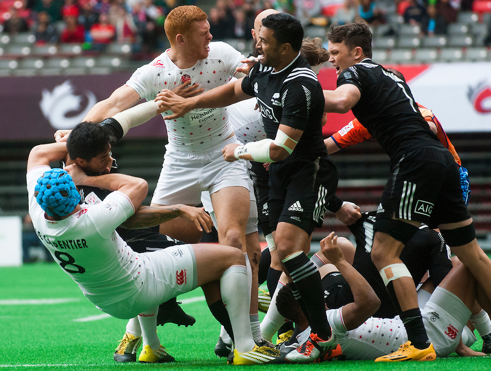 England and New Zealand players scuffle during the pool stages of the 2016 Canada Sevens leg of the HSBC Sevens World Series Series at BC Place in  Vancouver, British Columbia. Saturday March 12, 2016.<br /> <br /> Jack Megaw<br /> <br /> www.jackmegaw.com<br /> <br /> 610.764.3094<br /> jack@jackmegaw.com