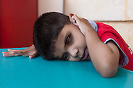 Eight-year-old Mohammed was born both deaf and blind and lives at the deaf-blind department of the Holy Land Institute for the Deaf in Salt, Jordan. His patient teachers are trying to teach him how to walk. He's also learning special sign language for the deaf-blind.