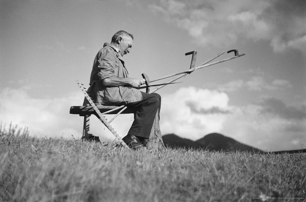 Testing scythes, Molln, Austria, 1935