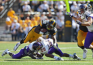 September 15 2012: Iowa Hawkeyes running back Damon Bullock (32) is hit by Northern Iowa Panthers defensive back J.J. Swain (28) during the first quarter of the NCAA football game between the Northern Iowa Panthers and the Iowa Hawkeyes at Kinnick Stadium in Iowa City, Iowa on Saturday September 15, 2012. Iowa defeated Northern Iowa 27-16.