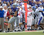 MANHATTAN, KS - OCTOBER 06:  Wide receiver Jordy Nelson #27 of the Kansas State Wildcats pulls in a pass for a 68-yard touchdown pass in front of defensive back Aqib Talib #3 of the Kansas Jayhawks in the first quarter, during a NCAA football game on October 6, 2007 at Bill Snyder Snyder Stadium in Manhattan, Kansas.  Kansas won 30-24.  (Photo by Peter Aiken/Getty Images)