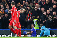 Martin Skrtel of Liverpool (2nd left) looks down at Diego Costa of Chelsea (right) after the Chelsea player went to ground in the penalty box during the Capital One Cup Semi Final 2nd Leg match between Chelsea and Liverpool at Stamford Bridge, London, England on 27 January 2015. Photo by David Horn.
