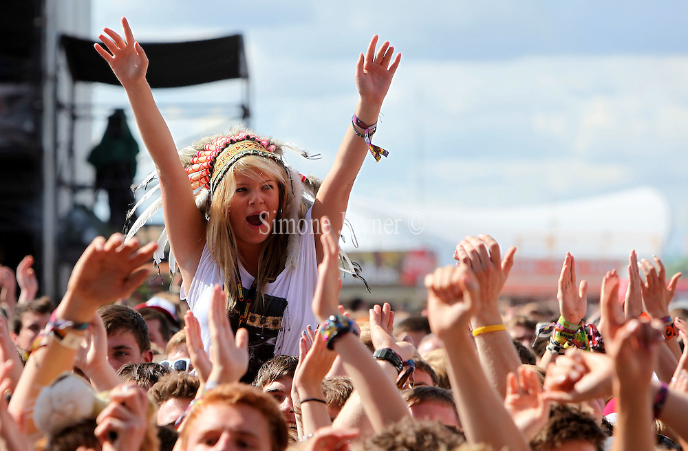 Music fans soak up the atmosphere as The Maccabees performs live on the Main stage during day Two of Reading Festival on August 28, 2010 in Reading, England.  (Photo by Simone Joyner)