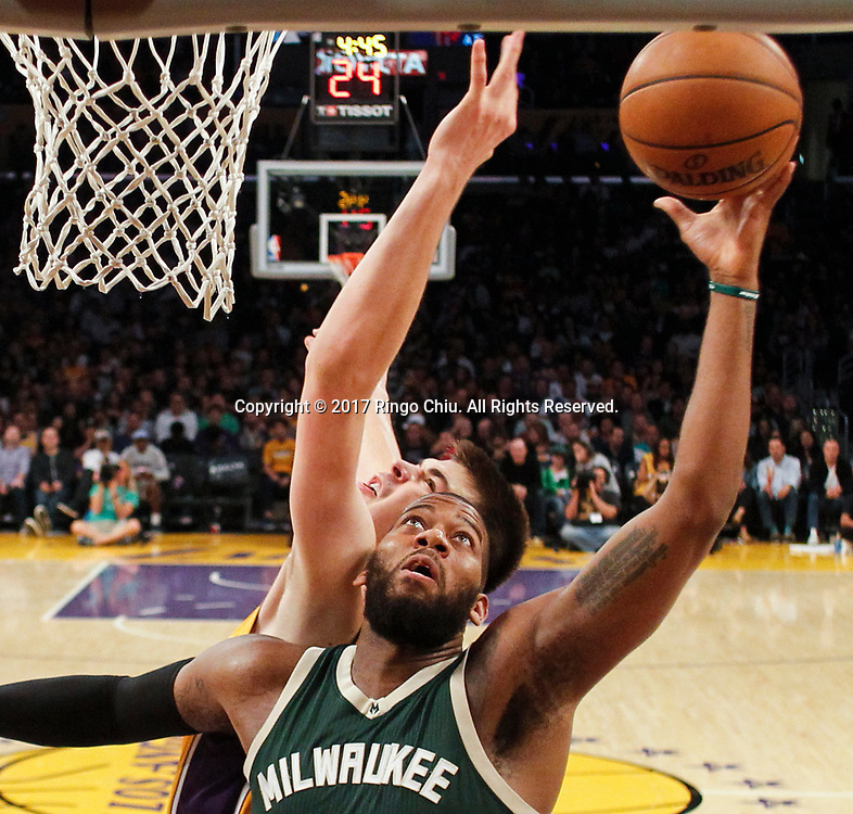 Milwaukee Bucks forward Greg Monroe (#15) goes up for a layup against Los Angeles Lakers center Ivica Zubac (#40) during an NBA basketball game, Friday, March 17, 2017.(Photo by Ringo Chiu/PHOTOFORMULA.com)<br /> <br /> Usage Notes: This content is intended for editorial use only. For other uses, additional clearances may be required.