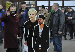 March 28, 2019 - Kiev, Ukraine - People are seen taking pictures of dummies of Ukrainian presidential candidates  Yulia Tymoshenko and Volodymyr Zelensky in Kiev. .Presidential elections in Ukraine will be held March 31, 2019. (Credit Image: © Sergei Chuzavkov/SOPA Images via ZUMA Wire)