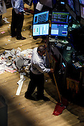 Janitors sweep the trading floor at the New York Stock Exchange - NYSE - following the closing bell. October 10th 2008 was a historic low for the Dow Jones index.