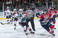 KELOWNA, CANADA - MARCH 27: Joe Gatenby #28 of Kelowna Rockets skates against Jordan Topping #12 of Tri-City Americans on March 27, 2015 at Prospera Place in Kelowna, British Columbia, Canada.  (Photo by Marissa Baecker/Shoot the Breeze)  *** Local Caption *** Jordan Topping; Joe Gatenby;