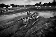 """A jerico and its pilot train for the Grand Prix at Alto Paraiso, Brazil, on Friday, Feb. 15, 2008. In these trainings, pilots try to learn all the tricks of such a terrain, in order to avoid bad surprises at the competition...:: BRIEF CONTEXTUALIZATION ::..Once a year, the small city of Alto Paraiso becomes the ultimate destination for all the motor enthusiasts in the Amazon area. With only 6,500 habitants in its urban area, every February the city becomes densely packed with more than 45,000 visitors coming from all over the region, a multitude of men and women united by their passion for music, mud and diesel smoke..In a race track made of dirt and water from the abundant Amazonian rains, vehicles which seem to come from a Hanna & Barbera cartoon dispute, from mud puddle to mud puddle, the most exotic grand prix of the Brazilian automobilism. While the high and typical roar of their stationary motors echoes all over the """"autodrome"""", the jericos* and its pilots fight amidst lots of smoke and mud in the eyes for a better performance in the narrow and slippery circuit of Alto Paraiso. Every victory, every passing is effusively celebrated in dionysiac mud baths..By the end of the week, the peaceful city in the heart of the Amazon Forest goes back to normality and the jericos*, once fast and furious machines, are back again to the calm rhythm of the countryside, carrying the heavy weight of life over their trunks...* Jerico is the suggestive name of this makeshift vehicle, very popular in the Amazon and famous for its capacity of carrying weight. Meaning mule in Portuguese, these machines are commonly built by putting together a steering wheel, a junked chassis and a mining pump engine."""