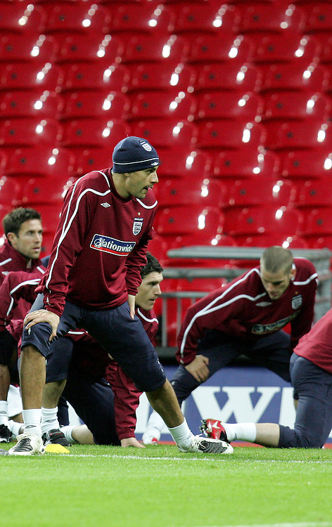 Rio Ferdinand stretches as Fabio Capello takes charge of his first England training session in front of the media at Wembley Stadium, 4th Feb 2007.