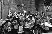 Pots and pans piled up in a market in Mombasa, Kenya