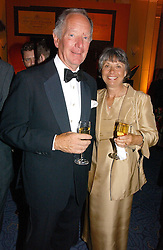 MR & MRS MICHAEL BUERK at a reception for the winners of the 2006 Veuve Clicquot Award - Business Woman of the Year held at Claridge's Hotel, brook Street, London on 27th April 2006.  This years winner was Vivienne Cox, BP CEO for Gas, Power, Renewables and Integrated Supply & Trading.  The awards were presented by the Rt.Hon.Gordon Brown MP - The Chancellor of the Exchequer.<br />
