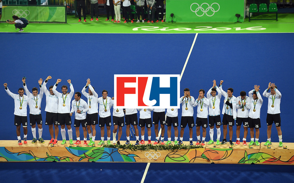 Gold medallists Argentina's players celebrate on the podium during the men's field hockey medals ceremony of the Rio 2016 Olympics Games at the Olympic Hockey Centre in Rio de Janeiro on August 18, 2016. / AFP / MANAN VATSYAYANA        (Photo credit should read MANAN VATSYAYANA/AFP/Getty Images)