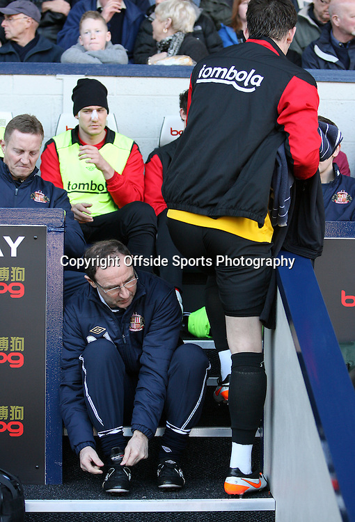 25/02/2012 - Barclays Premier League - West Bromwich Albion vs. Sunderland - Sunderland manager Martin O'Neill sits on the steps as a player squeezes past him - Photo: Simon Stacpoole / Offside.