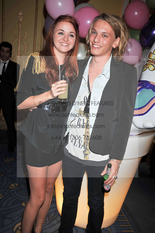 Actor JAMIE CAMPBELL BOWER and ZOE GRAHAM at a party hosted by Mulberry during London fashion Week 2009 at Claridge's Hotel, Brook Street, London on 20th September 2009.