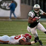 Dec 11, 2011; East Rutherford, NJ, USA; New York Jets running back Shonn Greene (23) breaking a tackle during the first quarter against the Kansas City Chiefs at MetLife Stadium.