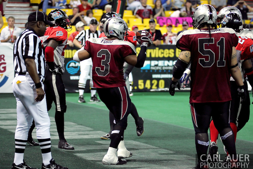 6-28-2007: Anchorage, AK - Thomas Ford Jr. (3) of the Wild celebrates a touchdown in the Alaska Wild 47 to 53 loss to the CenTex Barracudas at the Sullivan Arena.