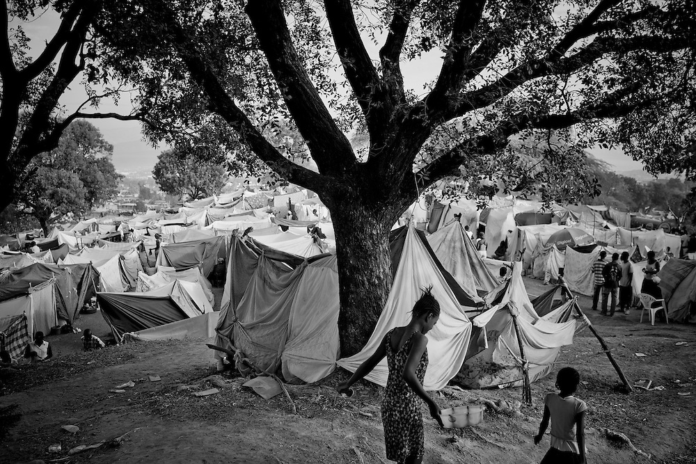 A woman walks through a camp for those displaced by the recent earthquake in Petionville, outside Port-au-Prince, Haiti.