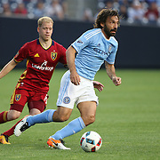 NEW YORK, NEW YORK - June 02: Andrea Pirlo #21 of New York City FC on the ball watched by Luke Mulholland #19 of Real Salt Lake during the NYCFC Vs Real Salt Lake regular season MLS game at Yankee Stadium on June 02, 2016 in New York City. (Photo by Tim Clayton/Corbis via Getty Images)
