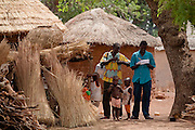 Health workers walk through the village of Wantugu, northern Ghana during a national polio immunization exercise in the village of Wantugu, northern Ghana on Friday March 27, 2009.