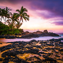 Pa'ako Cove Secret Beach Maui Hawaii sunrise photo with Ahihi Bay. Also known as Wedding Beach and Makena Cove, Pa'ako Cove is a popular beach in Wailea Kihei Hawaii. Copyright ⓒ 2019 Paul Velgos with All Rights Reserved.