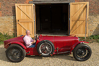 "Julian Majzub, founder / owner of ""Blockley tyre"" at home in Gloucestershire. Maserati Type 26M from 1931."