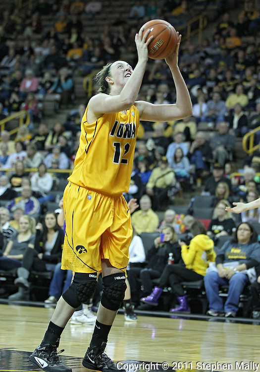 December 30, 2011: Iowa Hawkeyes center Morgan Johnson (12) puts up a shot during the NCAA women's basketball game between the Northwestern Wildcats and the Iowa Hawkeyes at Carver-Hawkeye Arena in Iowa City, Iowa on Wednesday, December 30, 2011.