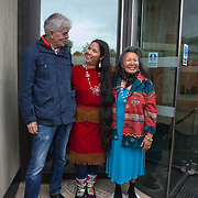 First Nation woman Kiera Dawn-Kolson flanket by fellow First Nation lady and John Sauven, director of Grenpeace. She lives in Canada and her land is endangered by Shell and other oil drilling companies. The giant polar bear puppet Aurora made by Greenpeace walked the streets of London in defence of the Arctic as part of a Greenpeace global day of action. The parade,part performance part protest, was to highlight the melting ice caps and the increasing and potentially devastating oil drilling in the arctic sea. Shell is one of the companies drilling and the march through London ended up outside Shell London HQ to draw attention to their oil business in the arctic. Aurora, the biggest polar bear in the world represents all endangered species in arctic