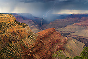 Lightning from a summer thunderstorm strikes near the Colorado River. Grand Canyon National Park in Arizona.