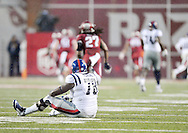 Ole Miss Rebels offensive lineman Laremy Tunsil (78) watches as Arkansas Razorbacks safety Rohan Gaines (26) scores on an interception return at Donald W. Reynolds Razorback Stadium in Fayetteville, Ark. on Saturday, November 22, 2014. Arkansas won 30-0.