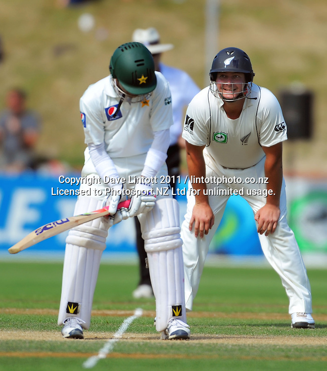 Pakistan's Adnan Akmal waits for a delivery as a smiling Jesse Ryder looks on. 2nd cricket test match - New Zealand Black Caps v Pakistan, day three at the Basin Reserve, Wellington, New Zealand on Monday, 17 January 2011. Photo: Dave Lintott / photosport.co.nz
