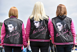"© Licensed to London News Pictures. 23/07/2017. London, UK. Fans attend the capital's first ever ""Elvis Fest"" to mark the 40th anniversary of the King of Rock N' Roll's death.  Taking place in Parsloes Park, Dagenham, the festival includes a variety of tribute acts representing Elvis through his career. Photo credit : Stephen Chung/LNP"