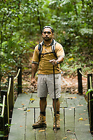 A young aboriginal guide leads visitors through the rainforest of the Daintree Eco Lodge in far north Queensland