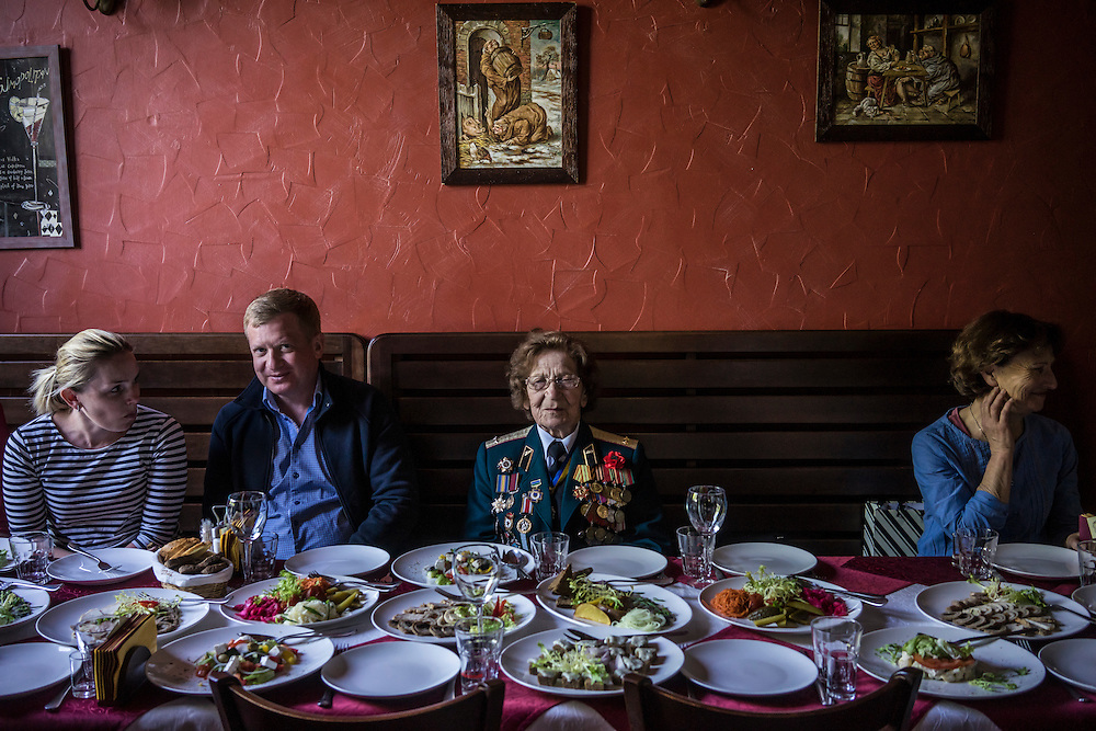 A woman who is a veteran of World War II eats lunch in a restaurant during Victory Day commemorations on Saturday, May 9, 2015 in Kyiv, Ukraine.