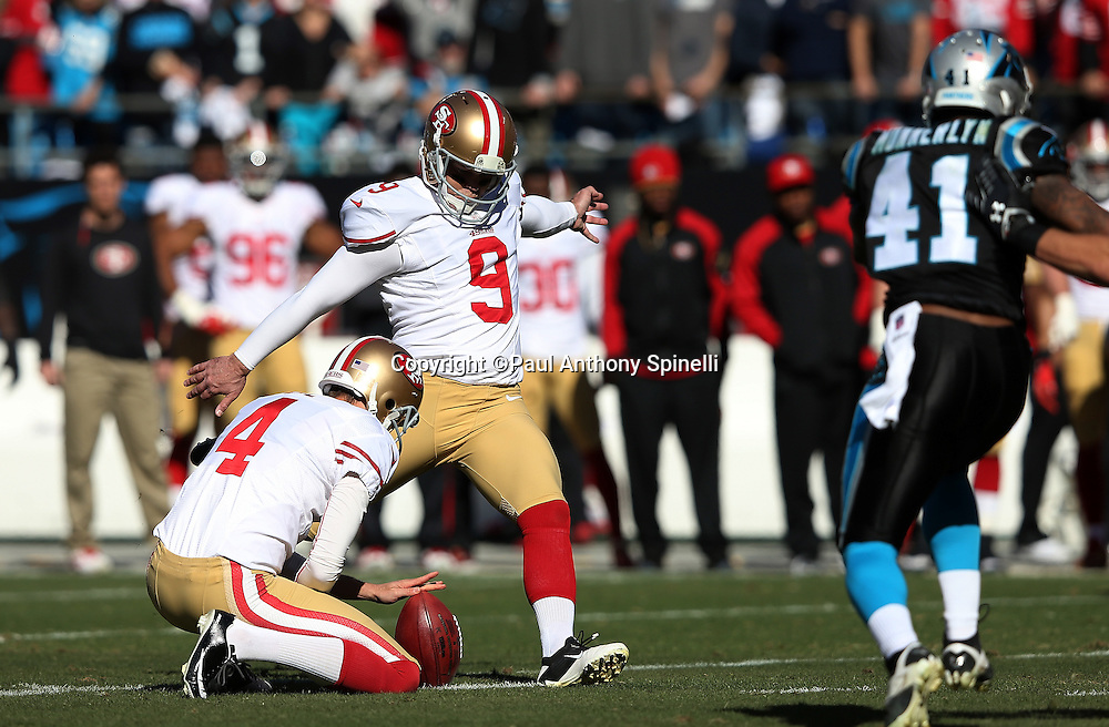 San Francisco 49ers punter Andy Lee (4) holds as San Francisco 49ers kicker Phil Dawson (9) kicks a 49 yard field goal good for a 3-0 Niners lead during the NFC Divisional Playoff NFL football game against the Carolina Panthers on Sunday, Jan. 12, 2014 in Charlotte, N.C. The 49ers won the game 23-10. ©Paul Anthony Spinelli