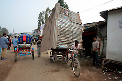 BANGLADESH TONGI 4FEB07 - A tinsheet hut loaded onto the back of a rikshaw van is transported during the last day of the BiswaIjtema outside Tongi, a northern suburb of the capital city Dhaka. The annual Tablighi Jamaat Islamic movement congregation lasts three days and is attended by over two million Muslims, making it the second largest congregation after the Hajj to Mecca. Devotees from approximately 80 countries, including the host country, Bangladesh, attend the three-day Ijtema seeking divine blessings from Allah. The event focuses on prayers and meditation and does not allow political discussion. The local police estimated the number of attendees of the 2007 Ijtema to be 3 million...jre/Photo by Jiri Rezac..© Jiri Rezac 2007..Contact: +44 (0) 7050 110 417.Mobile:  +44 (0) 7801 337 683.Office:  +44 (0) 20 8968 9635..Email:   jiri@jirirezac.com.Web:    www.jirirezac.com..© All images Jiri Rezac 2007 - All rights reserved.