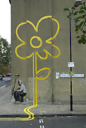 Banksy Street Artist. Painter resting painted on the Pollard Row E2 wall of the Bethnal Green Working Mens Club London..PIC JAYNE RUSSELL. 01.11.2007