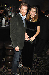 TOM & AMBER AIKENS at a party to celebrate the launch of the Astley Clarke Fine Jewellery Collection held at The Connaught hotel, London W1 on 28th February 2008.<br />