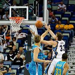 October 9, 2010; New Orleans, LA, USA; Memphis Grizzlies center Marc Gasol (33) shoots over New Orleans Hornets center Aaron Gray (34) during the first quarter of a preseason game at the New Orleans Arena. Mandatory Credit: Derick E. Hingle