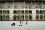 Family in Wawel Castle courtyard, Krakow, Poland.