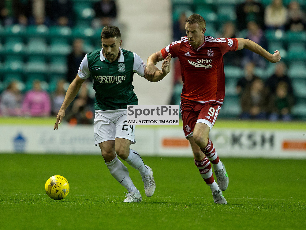 Hibernian FC v Aberdeen FC<br /> <br /> Darren McGregor and Adam Rooney during the Scottish League Cup clash between Hibernian and Aberdeen FC at Easter Road Stadium on 23 September 2015.<br /> <br /> <br /> Picture Alan Rennie.