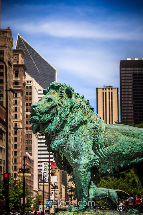 Photo of Chicago lion statues at the Art Institute of Chicago. The bronze lions are a popular Chicago attraction and one of Chicago's most recognizable symbols.