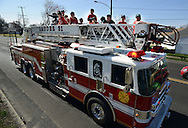 FAIRLESS HILLS, PA - APRIL 12: Baseball players sit on top of a fire engine and wave to the crowd during the Fairless Hills Little League opening day parade on North Oxford Valley Road April 12, 2014 in Fairless Hills Pennsylvania. (Photo by William Thomas Cain/Cain Images)