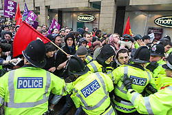 © Licensed to London News Pictures . Bolton, UK . FILE PHOTO DATED 20/03/2010 of Unite Against Fascism supporters and police clashing during an English Defence League demonstration in Bolton as today (30th August 2013) it's been revealed that Greater Manchester Police have paid out tens of thousands of pounds in return for protestors not pursuing civil claims against them following arrests made at the demonstration in March 2010 . Photo credit : Joel Goodman/LNP